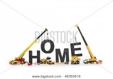 Building up a home concept: Black alphabetic letters forming the word home being established by group of construction machines, isolated on white background.