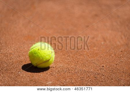 tennis ball in sand