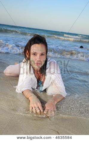Wet Woman In The Sand