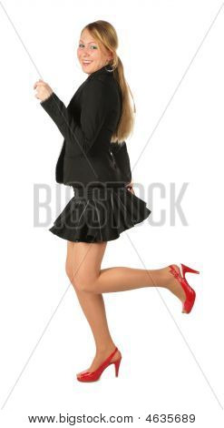 Young Girl In Suit Runs