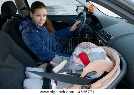 Mother And Child In Car Safety Seat