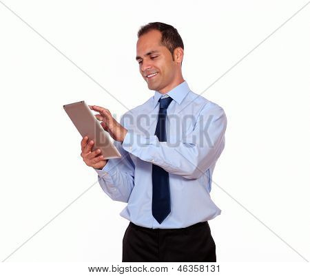 Attractive Latin Adult Man Using His Tablet Pc