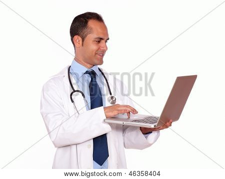 Charming Medical Doctor Using His Laptop