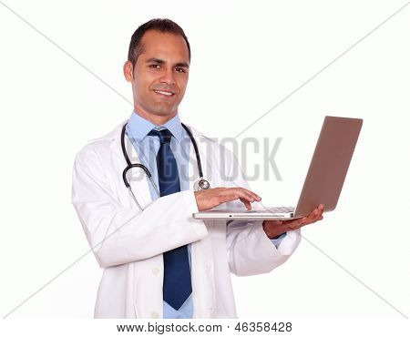Charming Medical Doctor Working On His Laptop