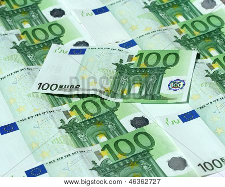 background of 100 euro bank notes and one