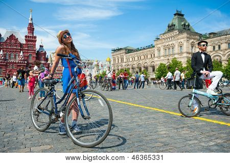 MOSCOW - MAY 19: Cyclists pose during the Day of the Uniform Bike Action on May 19, 2013 in Moscow. During this event many cyclists ride bicycles in an unusual wear and took part in the flash mobs