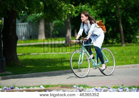 MOSCOW - MAY 19: Cyclist rides during the Day of the Uniform Bike Action on May 19, 2013 in Moscow. During this event many cyclists ride bicycles in an unusual wear and took part in the flash mobs