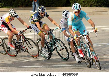 BARCELONA - MARCH, 24: Andrey Kashechkin(R) of Astana rides during the Tour of Catalonia cycling race through the streets of Monjuich mountain in Barcelona on March 24, 2013