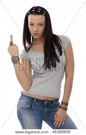 Provocative young girl showing middle finger gesture, wearing spider ring.
