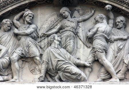 The Martyrdom of St. Stephen pediment of the front door of the Saint Etienne du Mont Church, Paris.