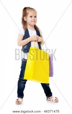 The little girl with a two packages isolated