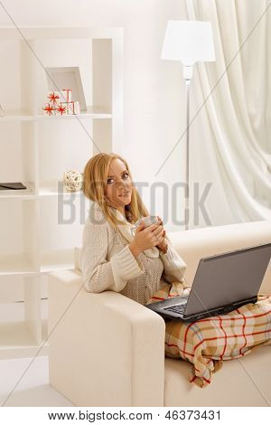 beauty girl with laptop in the room