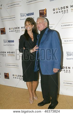 BEVERLY HILLS - MAY 7: Buzz Aldrin and wifearrives at The 12th Annual Golden Hearts Awards presented by The Midnight Mission on Monday, May 7, 2012 at the Beverly Wilshire Hotel in Beverly Hills, CA.