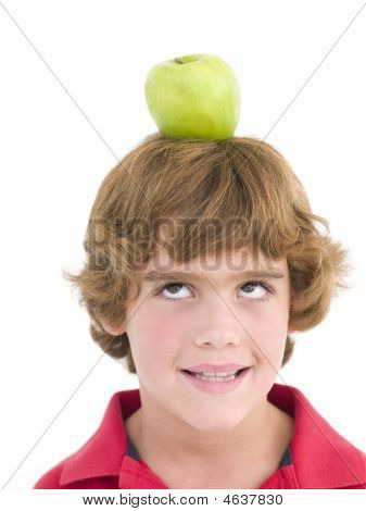 Young Boy With Apple On His Head Smiling