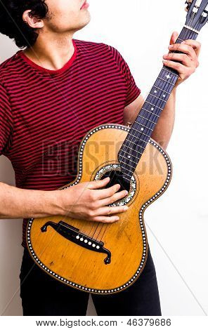 Young Multiracial Man Playing Flamenco Guitar