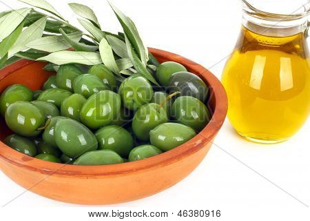 Olive Oil And Branches Of An Olive Tree