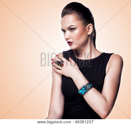fashion girl in jewelry. Professional make up and hairstyle