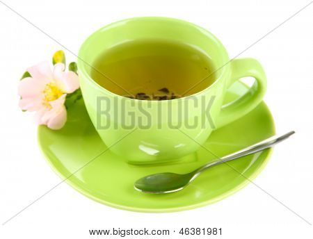 Cup of herbal tea with hip rose flower, isolated on white