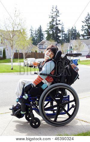 Happy Little Disabled Boy In Wheelchair