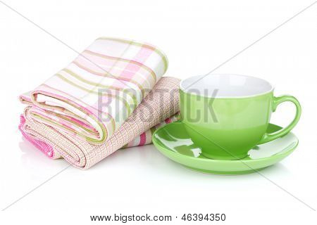 Green coffee cup and kitchen towels. Isolated on white background