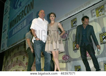 ANAHEIM, CA - MARCH 31: Marc Guggenheim and Willa Holland pose for photos at the 2013 Wondercon convention on March 31, 2013 in Anaheim, CA.