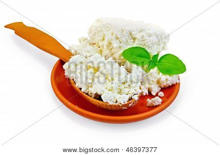 Curd In A Spoon And A Plate Of Clay