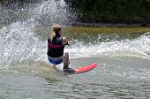 picture of ski boat  - A young girl on a slalom course during a competition - JPG
