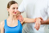 stock photo of physiotherapy  - Female Patient at the physiotherapy doing physical exercises with her therapist - JPG