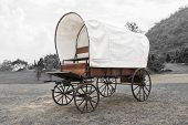 picture of covered wagon  - Black & White photo of old wagon wheels Covered wagon in park