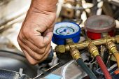 foto of hand truck  - Compressed air car components to be repaired