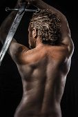 stock photo of sword  - Warrior with sword - JPG