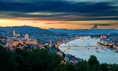 stock photo of hungarian  - Panoramic view of Budapest and river Danube at dusk - JPG