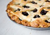 stock photo of sugar  - blueberry pie lattice crust with sugar whole pie - JPG