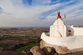 stock photo of hanuman  - Hanuman Temple on the sacred Anjenadri hill in Hampi Karnataka state India - JPG