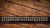 picture of gunslinger  - Vintage western bullets on wooden table  - JPG