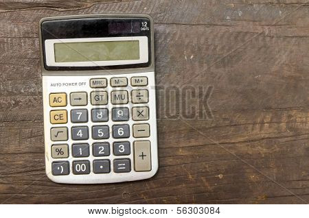 The Old Calculator On Wooden Table