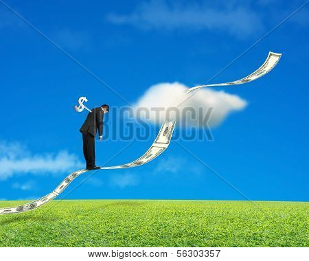 Businessman Standing On Growing Money Trend With Meadow And Sky