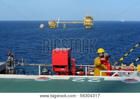 Fireman Is Guarding For Offshore Helicopter Before Start Up Engine At Oil Rig