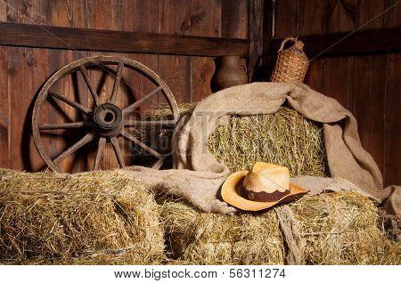 Interior of a rural farm - hay wheel cowboy hat.