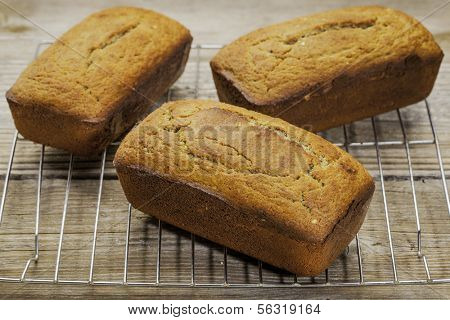 three loafs of freshly baked gluten free bread prepared with coconut and almond flour, flaxseed meal with sesame seeds
