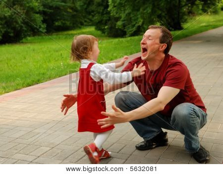 Laughing Man (father) Playing With Little Girl (daughter)