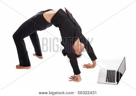 Suited Woman In Yoga Pose Working With Laptop.
