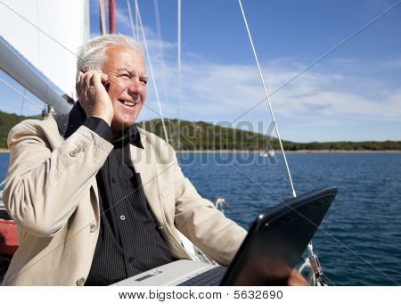 Businessman On The Boat.