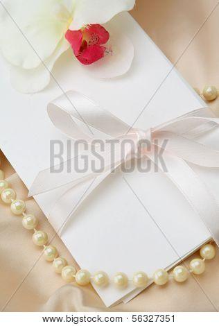 Invitation card on silk satin background.