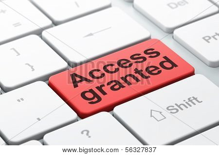Protection concept: Access Granted on computer keyboard background