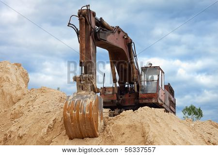 Dredge on a heap of sand