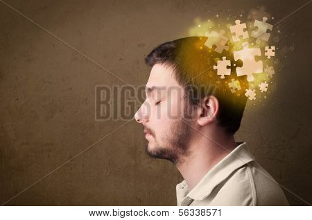 Young person thinking with glowing puzzle mind on grungy background