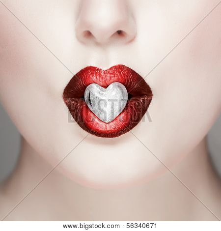 Glamour red lips with little heart
