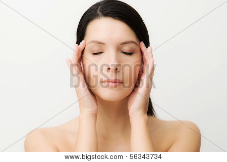 Spiritual Woman With Her Fingers To Her Temples