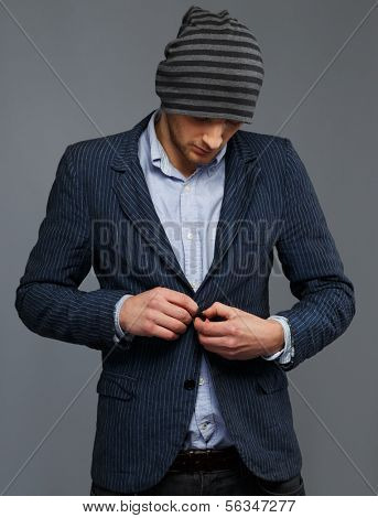 Stylish young man in jacket and beanie hat